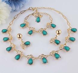 Oro 18k nueva de la manera joyería llenada turquesa austríaco claro anillo del pendiente del collar de la pulsera cristalina fijada para las mujeres desde pendientes de turquesa juego de anillos fabricantes