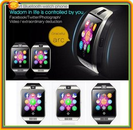 Wholesale 100 dhl free News SIM card Bluetooth3 Smart Watch phone q18 with TF FM pedometer alarm clock camera bluetooth sync