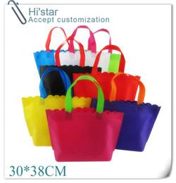 30 * 38CM bolso de compras no tejido de la impresión de la insignia de la aduana 20pcs / lot usado para la promoción / el regalo / el anuncio y los propósitos de las compras desde armadura usada fabricantes