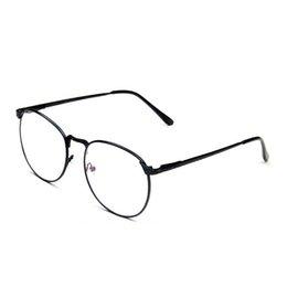 Men s round eyeglass frames en venta-Al por mayor-Hombres metal de la aleación ronda marco gafas gafas de alta calidad para la protección de la radiación mujeres lente película 2015 nueva llegada del otoño