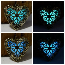 Wholesale 2015 New Copper Heart Shaped Hollow Antique Bronze Glow In Dark Pendant Necklace Fashion Creative Gifts Free Chain For You