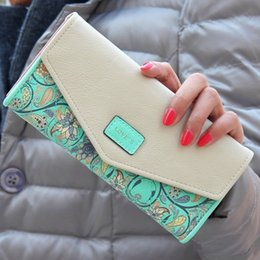 The new 2016 han edition rural small broken flower ling, thirty percent bump color envelope buckles ms long purse sell wholesale and retail