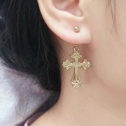 Qingdao Europe and the United States jewelry simple golden cross angel girl asymmetric hanging earrings