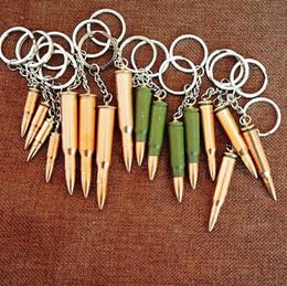 Wholesale Stylish Creative Mini Gadget Metal Key Chain Bullet Artificial Pistol Bullet Keychain Fashion Accessories