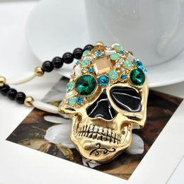 New Korean Vintage Skeleton Necklace Women Cat eyes stone Hollow out Skull Rhinestone Pendant women fashion jewelry FYSS1004W