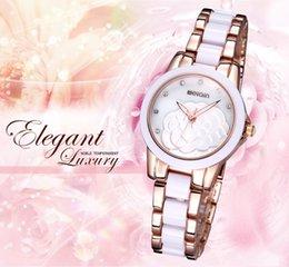 Wholesale Solid Gold Wrist Watches - Solid flower elegant women luxury gold wrist watch ceramic bracelet watch charm office female rhinestone quartz brand clock