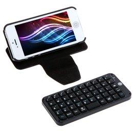 Caso de cuero del teclado del iphone en venta-Al por mayor-Ultra-delgada Mini teclado Bluetooth V3.0 inalámbrico con estuche de cuero de la cubierta protectora para el iPhone 5 Negro