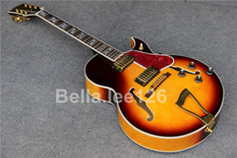 Wholesale Hot selling music instrument classical sunburst color hollow body jumbo jazz archtop electric guitars factory OEM handmade guitar