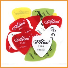 Profesional Alicia 200pcs 0.58mm de alta calidad lisa Nylon Estándar guitarra acústica eléctrica selecciona las púas Dropshipping desde guitarra acústica de nylon fabricantes