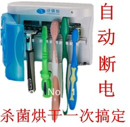 Wholesale Toothbrush sterilizer disinfecting toothbrush holder with microcomputer control automatic power off feature powerful magic stick