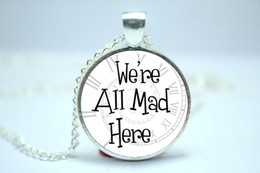 Wholesale 10pcs We re All Mad Here Spiral Clock Background Alice in Wonderland Necklace Glass Cabochon Necklace