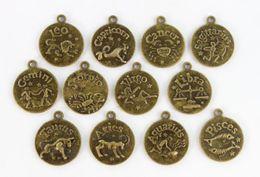 Wholesale m m de bronce Antiqued Cabochon ajustes del zodiaco encantos