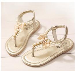 2015 de princesa Slip-On de la muchacha de las sandalias de la perla dulce de la flor dulce de las muchachas de la alta calidad que rebordea los zapatos de los niños 4 colores desde sandalias de perlas flores fabricantes