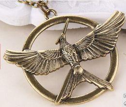 Wholesale golden Movie The Hunger Games Flying Eagle Dapeng wings Robin mockingbird pendant necklace boy men Hot x039