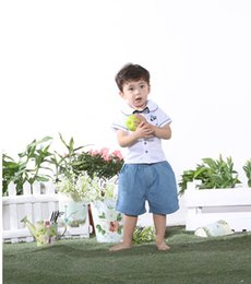 Wholesale 2016 boy lace Two Pieces Dresses T shirt shorts The New Summer Boys Lapel bow button shark sleeping bag Baby clothes casual dress
