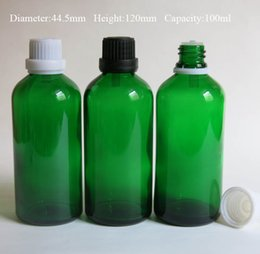 wholesale 10 Pcs Lot 100ml glass essential oil bottle with childproof cap   aromatherapy green glass bottles