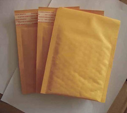 Burbuja de papel kraft en Línea-50pcs mucho oro Kraft burbuja Sobres Sobres acolchados bolsas de alta calidad bolsas de papel 122 * 178 + 40MM (5 '' * 7 '') Bolsos del regalo el envío libre