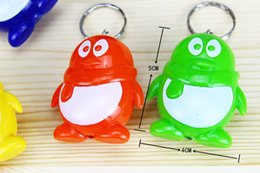 Wholesale Taobao promotional gift ideas QQ Penguin lighted keychain small gifts small gifts products activities