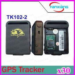 Wholesale 30pcs Quadband Car GPS Tracker GPS GSM TK102 Personal GPS Tracker With Shock Sensor Alarm Function Flash Memory Card Slot ZY DH