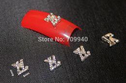 Wholesale 50pcs Alloy d brand logo nail art decoration DIY charms for nails Professional nail art supplier
