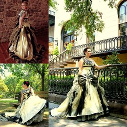 Exquisite Yellow Gothic Wedding Dresses Vintage Inspired Sexy V-Neck Big Bow Ruched Black Appliqued Sweep Train Corset Halloween Bridal Gown