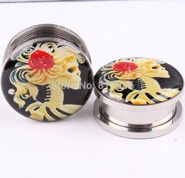 Mix 5-16mm 70pcs lot fashion human Girl logo ear plugs and tunnels body jewelry piercing