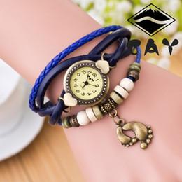 Cuero reloj pulsera corazón en Línea-Armadura de la manera Retro pulsera Relojes Wrap Relojes Piel Corazón relojes de pulsera de cuarzo de las mujeres Relojes Las nuevas mujeres pies de tamaño pulsera brazalete