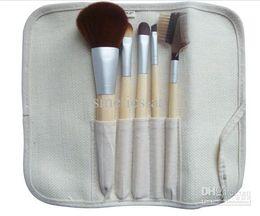Precio bajo 100pcs / lot NUEVA cepillos del maquillaje de 5 pedazos de bambú del sistema de cepillo desde conjunto de maquillaje cepillo de bajo precio fabricantes