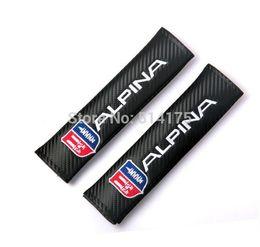 Acolchada electrónico en venta-Pad Hombrera 1pairs X Auto Alpina fibra de carbono Logotipo del cinturón de seguridad del cinturón de seguridad del coche de portada shiping libre por el correo aéreo del poste de la orden $ 18Nadie pista