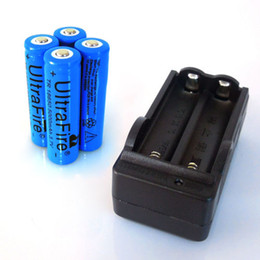 Wholesale New riginal rechargeable batteries v mAh Lithium li ion battery with Charger for Ultrafire LED Flashlight