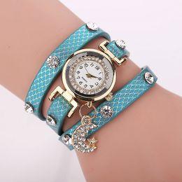 2015 Women Girl Elegant PU Leather Wrap Bracelet Crystal Embed Dial Star Moon Pendant Quartz Analog Wrist Watch