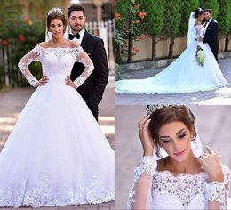 Said Mhamad Long Sleeve Wedding Dresses Off Shoulder See Through White Appliques Lace Bridal Dress Ball Gown Shape Long Train 2016