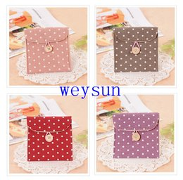 Wholesale DHL Freeshipping Small and pure and fresh Dot Pure color Sanitary napkin storage case Linen Hasp Cosmetic bag