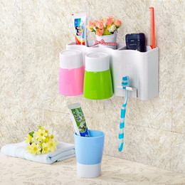 Wholesale Strong wall mounted Toothbrush Bathroom Shelves toothbrush cup suit family of four Cups with toothpaste Kit