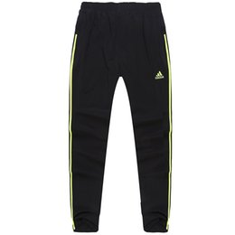 Wholesale Autumn free freight men s sports marathon track and field pants speed dry air pants