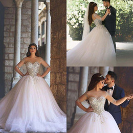 Luxury 2016 Crystal Beads Sheer Neckline Long Sleeve Ball Gown Wedding Dresses Sparkly Tulle Plus Size Chapel Bridal Gowns EN1086