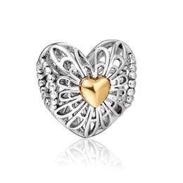 Venta caliente del encanto al por mayor 925 plata esterlina encantos flotantes cielo abierto de oro de los corazones europeos apta del grano DIY de la serpiente de la joyería pulsera de cadena desde corazón del oro de la pulsera 925 fabricantes
