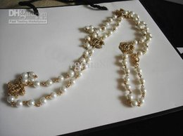 Wholesale long glass pearl stamped necklace Classic hollow out party wear sweater decoration high quality