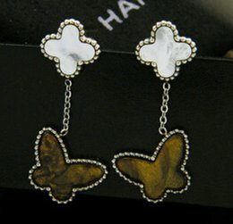 Butterfly-shaped white shell tiger eye stone earring tricolor