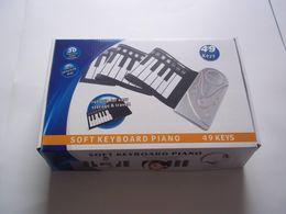 Piano del teclado suave 49 en Línea-Del envío 20pcs 49 Mano del piano llaves flexible rueda digital - Es un 49 suave teclado de piano con adaptador de energía libre