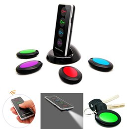 Wholesale 4 in Advanced Wireless Key Finder Remote Key Locator Anti Lost with Torch function receivers and dock buscador dominante