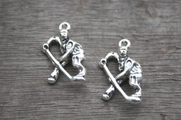 Wholesale 12pcs Hockey Charms Antique Tibetan Silver Hockey Player charm pendants x17mm