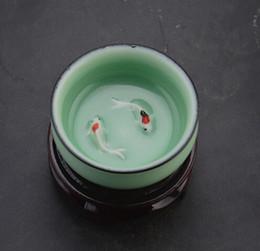 Wholesale Jingdezhen Ceramic Song Longquan Celadon Pisces motif beans cup glass household goods