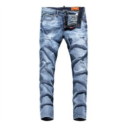 2016 original blue wash water hole in tight jeans stretch feet pants pencil pants beggar jeans men's model ZAS359