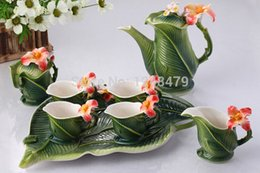 Wholesale Pottery teapot banana leaves mug porcelain craft decoration garden furniture art cup spoon set