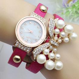 Acheter en ligne Nouvelles robes de filles de noël-10 couleurs New Fashion Rhinestone bowknot perle montre femmes bracelet en cuir bracelet Quartz robe Montres-bracelets cadeau de Noël pour dame fille