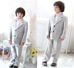 Los muchachos del smoking de los muchachos de la plata del envío rápido viste los pantalones que casan los juegos para los muchachos con la pajarita rosada (Jacket + Pants + Tie + Vest) desde lazo formal de color rosa proveedores