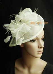Cream ivory Sinamay fascinator hat for wedding party.