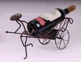 Wholesale 2pcs Creative home bar wine bottle holder home decor Factory direct European retro creative people to pull carts bronze wine rack