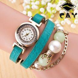 Acheter en ligne Montres de gros perle-Commerce de gros montre modèles chauds 2016 version européenne de la couronne trois fois chaîne de perles Montres en or
